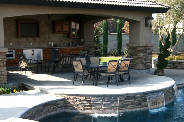 Incredible outdoor living space with pool, spa, outdoor kitchen and dining area.