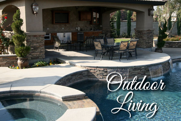 Custom Outdoor Living Space by Paradise Pools and Spas.