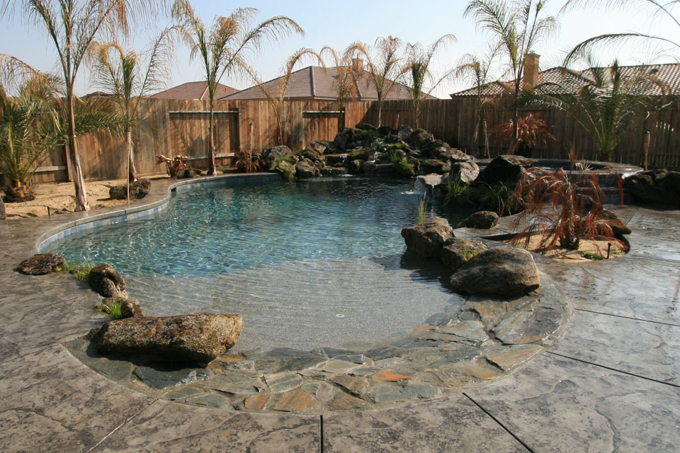 pool beach entry with live rock waterfall