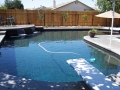 pool with raised patio with shear descants