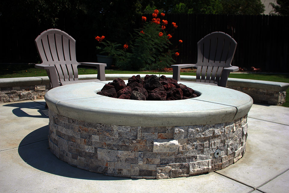 Beautiful gas fire pit in a gorgeous Bakersfield backyard.