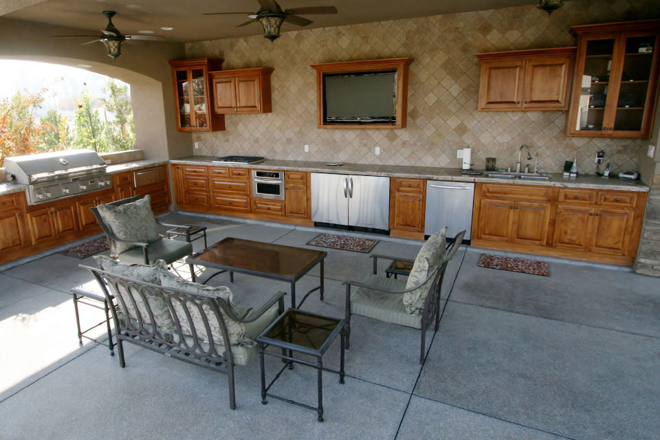 Outdoor kitchen, dining area and entertainment center that is part of this outdoor living area.