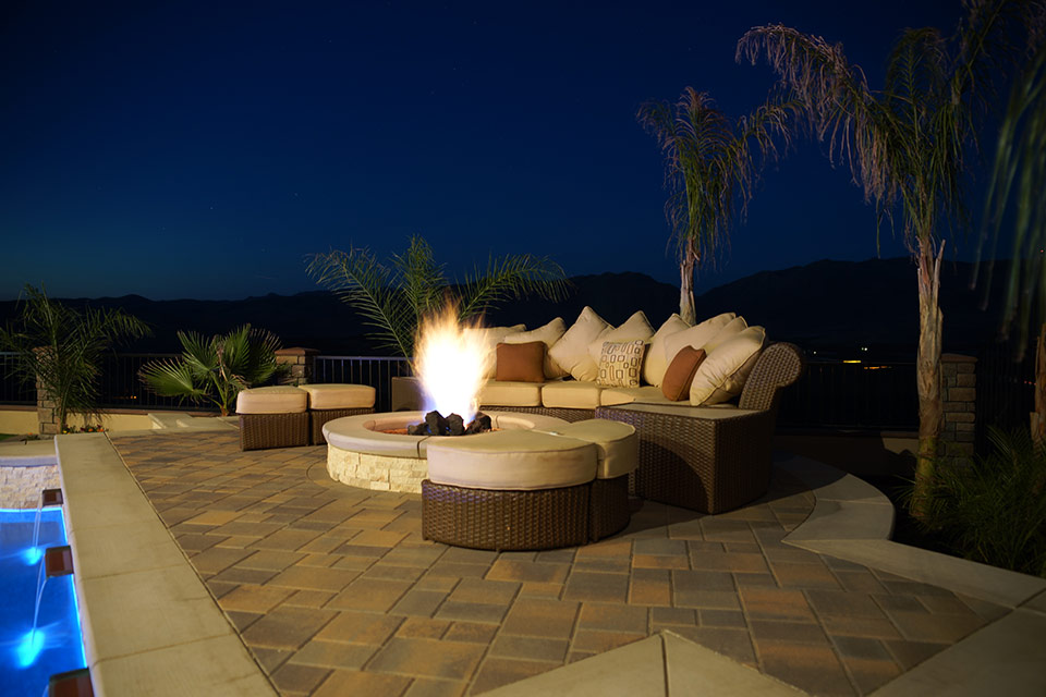 Comfortable seating poolside at a fire pit after the Bakersfield sun has gone down.
