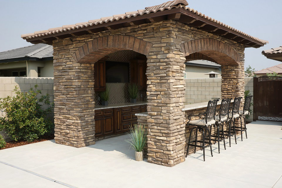 Outdoor covered bar with seating for four.