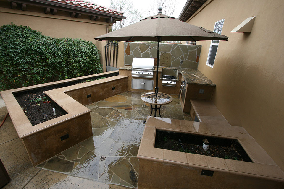 Outdoor kitchen and grill after the rain.