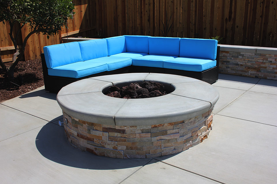 outdoor seating next to a fire pit.