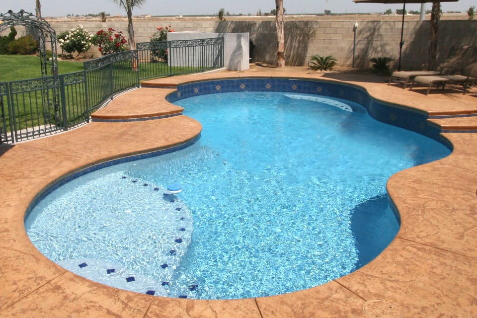 Custom 3 Bubble Pool with Raised Deck an beautiful tile work.