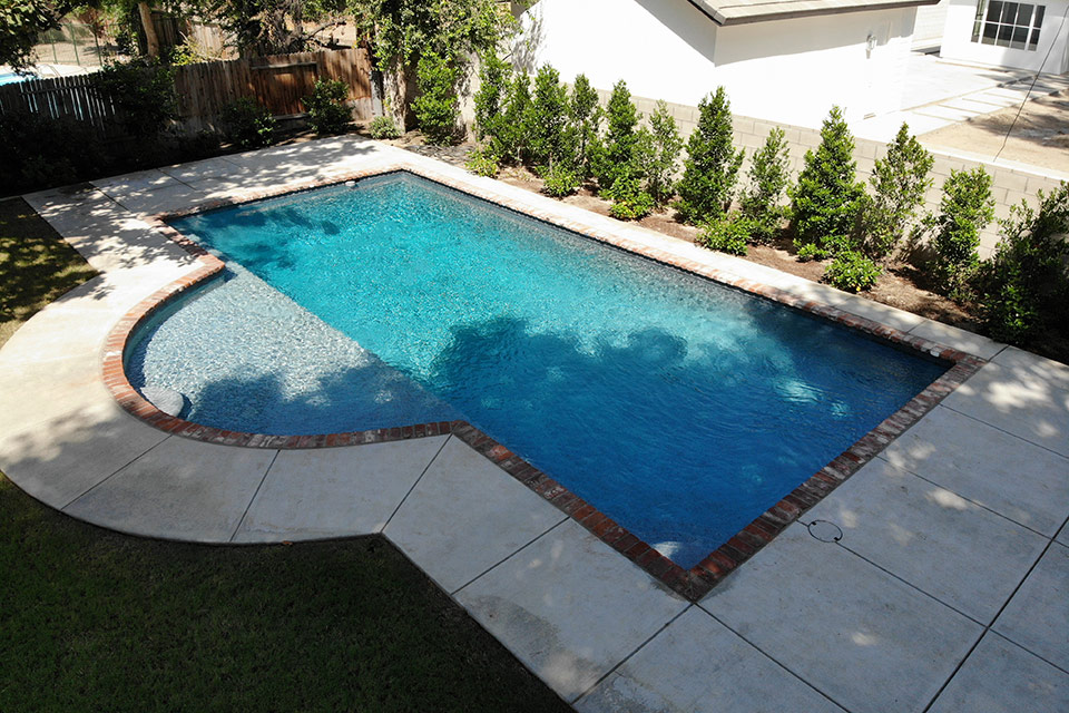 Custom swimming pool with client supplied brick.