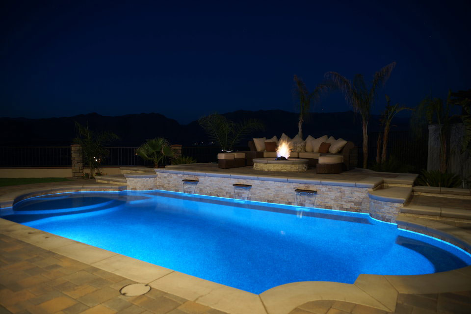 Grecian Pool with fire pit on a beautiful Bakersfield night.