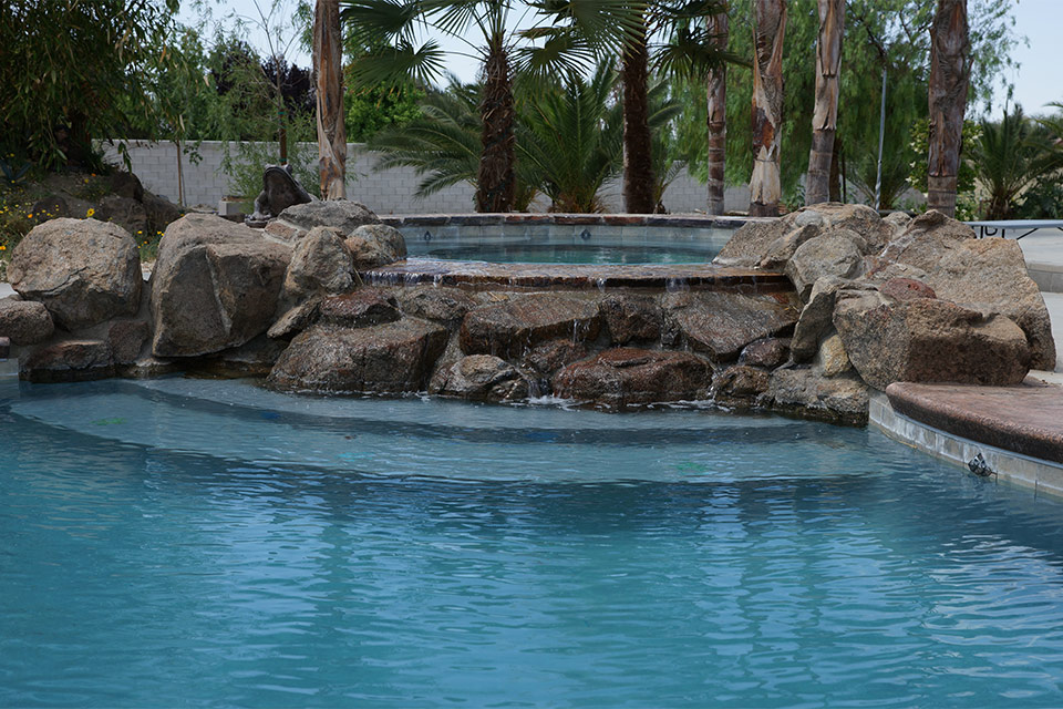Circular spa with natural rock waterfall built by Paradise pools & Spas, Bakersfield.