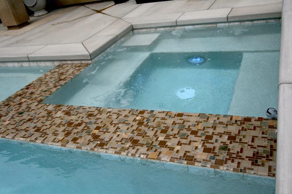 In-Pool spa with custom tile work.
