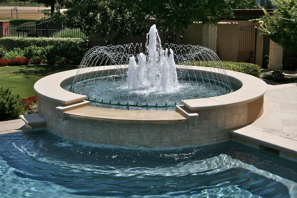 Beautiful custom fountain with a spillover.