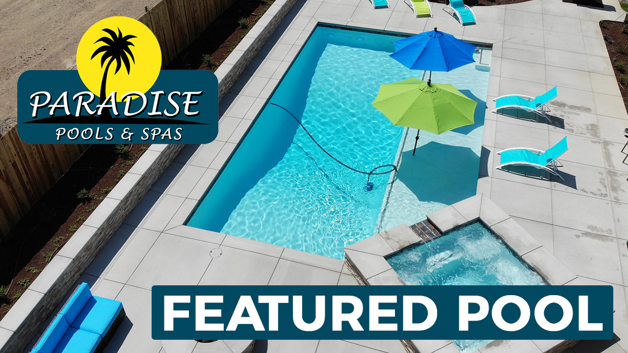 Colorful umbrellas and lighting highlight this featured swimming pool that's perfect for nighttime fun.