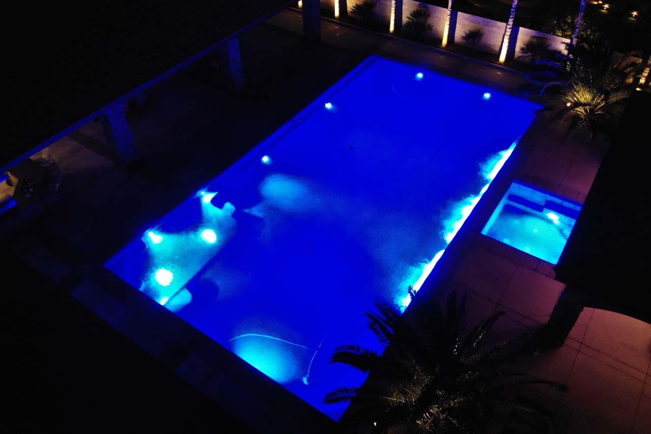 Aerial of Beautiful Pool Lit at Night