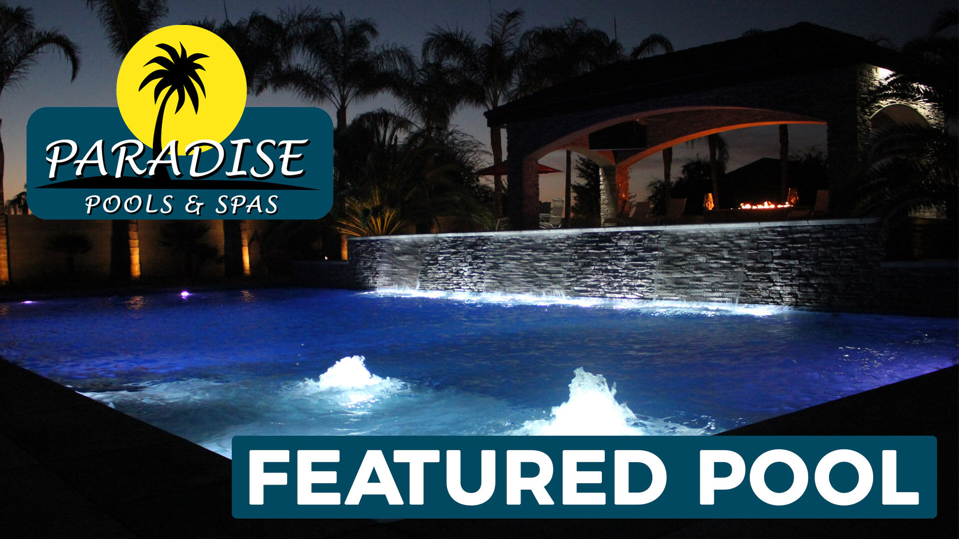 Beautiful Custom Swimming Pool Lit Up at Night