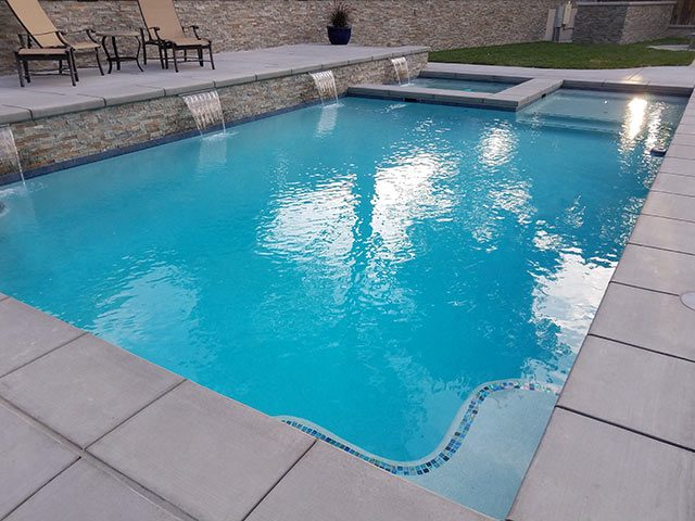 Beautiful Atascadero swimming pool with in pool spa and multiple scuppers.