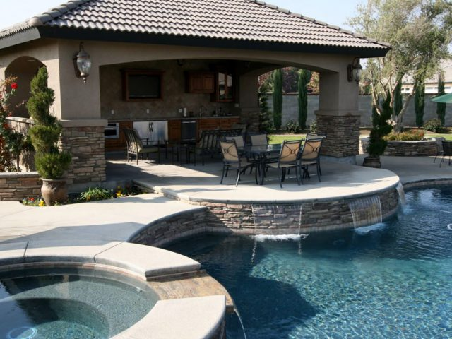 Outdoor kitchen, pool, spa, water features and multiple dining areas in this incredible outdoor living space created by Paradise Pools & Spas.