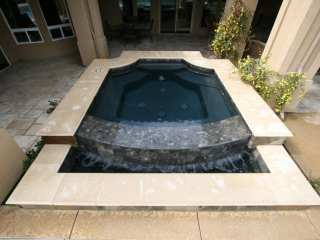 From the Paradise Pools & Spas Galleries: Grecian style spa with sheer descent in Bakersfield, CA.